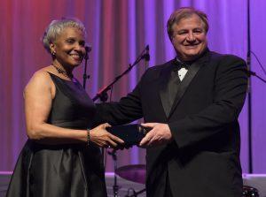 Josephine Rhymes accepting award from Joe Azar