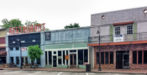Image of colorful storefronts on rural Mississippi town square